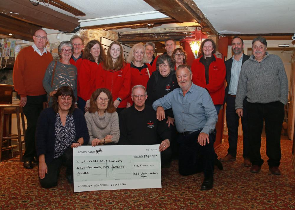 Richard Sarjent, front row right, Trustee of the Red Lion Charity Fund, and next to him Paul Hewer, Bandleader of The Cricklade Band - surrounded by members of the Charity Fund committtee and BandAcademy