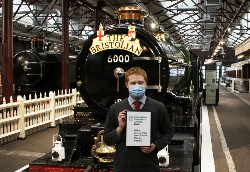 Adam Davies, Visitor Experience Officer, with Steam's TripAdvisor Travellers' Choice Award