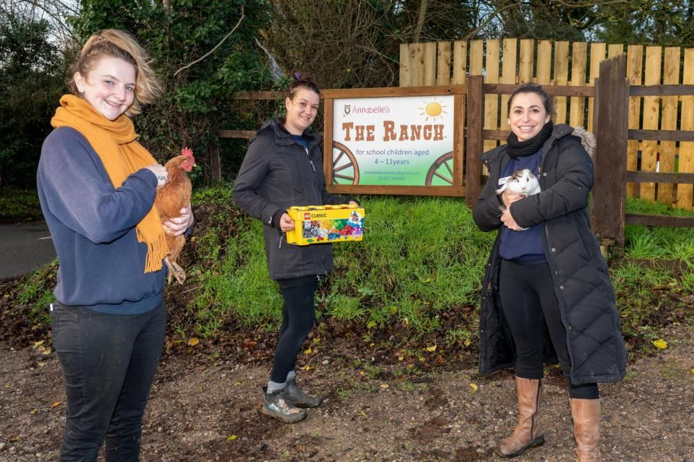 Carissa Pellegrini, Natasha McReadie & Chloe Fotheringham, who work at Annabelle's nursery in Faringdon, with the nursery's furry friends and one of the prizes given