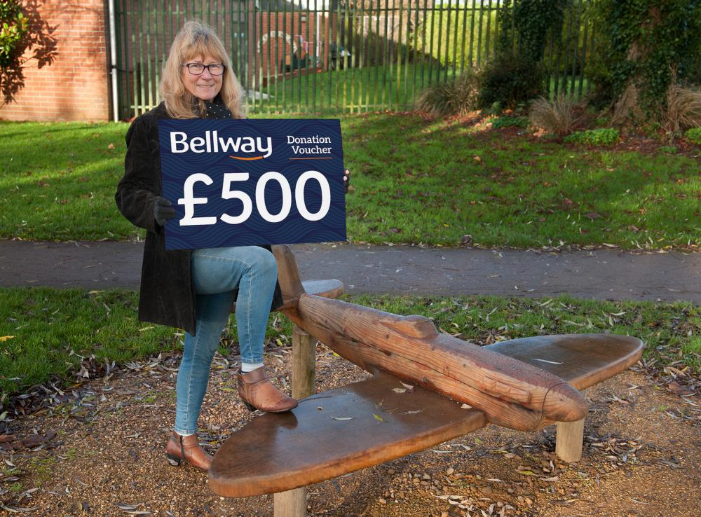 Beverley Margerison, vice chair of Vision 4 Wroughton, with the new Spitfire bench in Willow-Brook Gardens