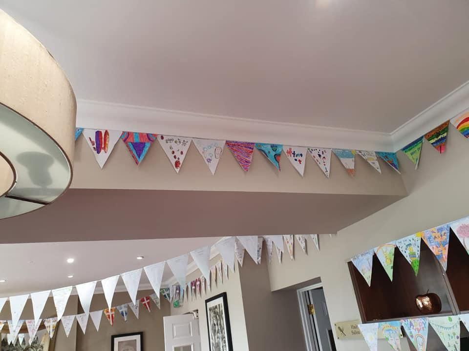 Children  create Easter bunting for care home