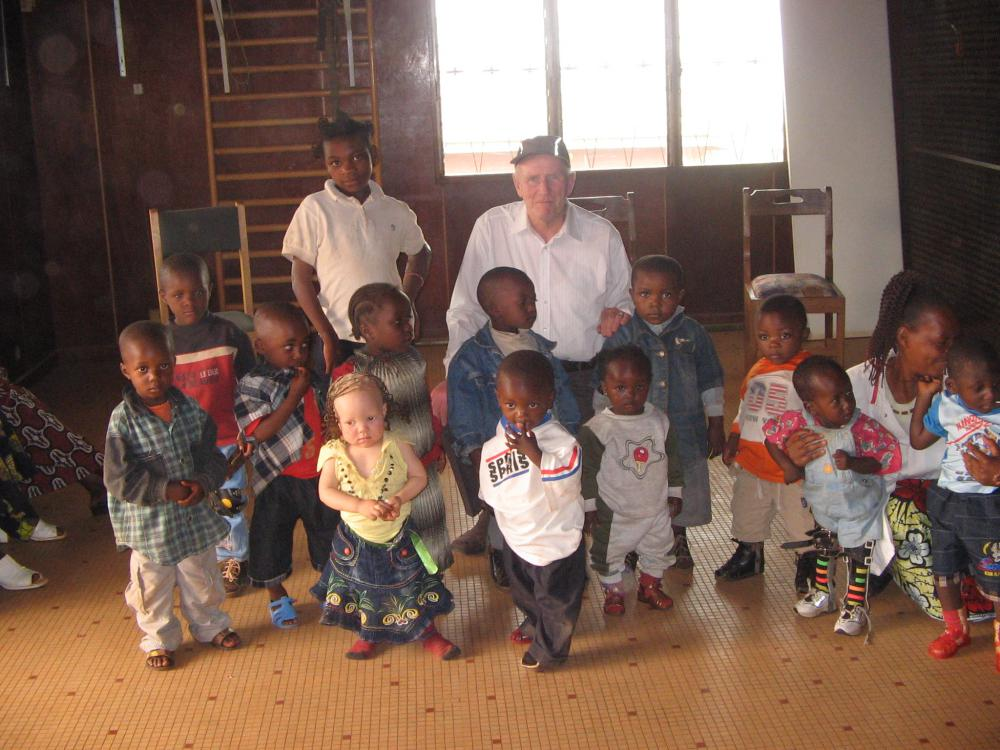 Mr Thomas with some of the children helped by the charity