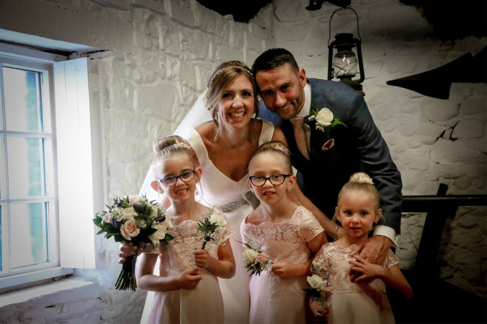 Karl and Charlotte and their daughters Erin, Libby and Cora, on their wedding day in 2019