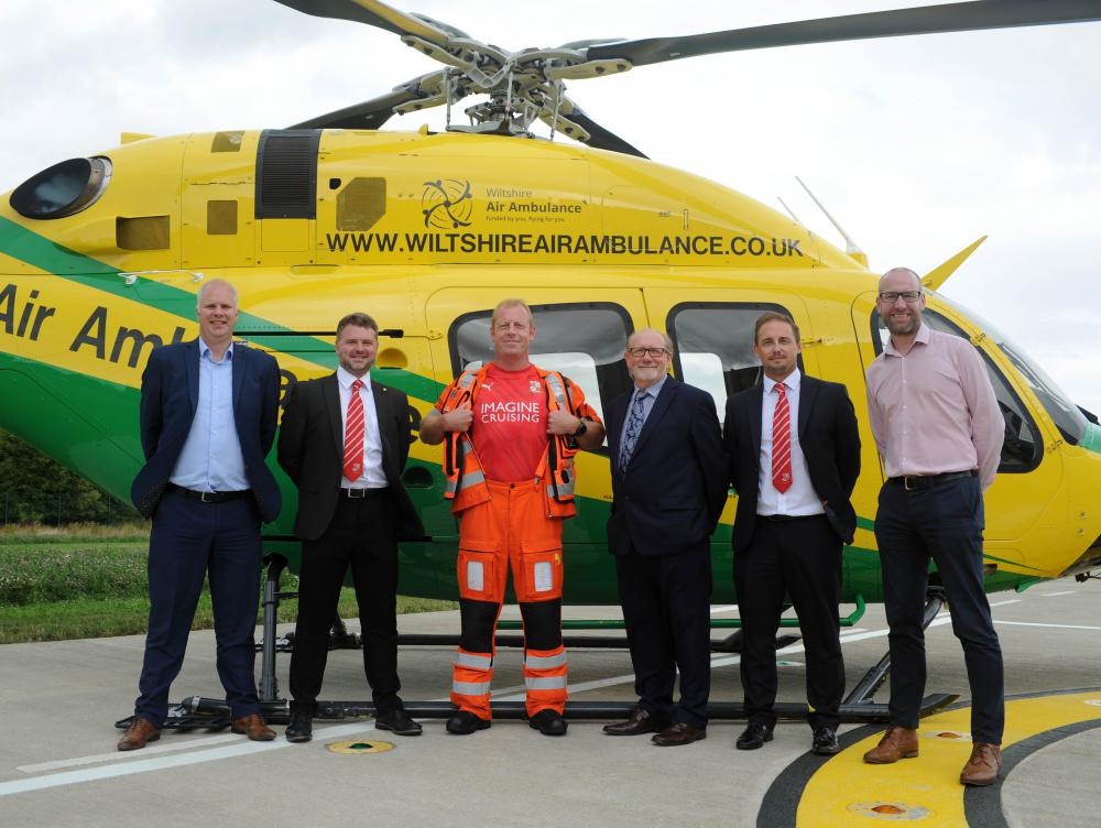 (L-r) Imagine Cruising's product and marketing manager Martin Palmer, Swindon Town's commercial manager Adam Wainwright, Wiltshire Air Ambulance trainee critical care paramedic Keith Mills, Wiltshire Air Ambulance chief executive David Philpott, Swindon Town chief executive Steve Anderson, Imagine Cruising director Steve Morrish.