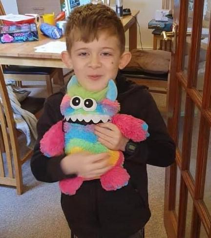 Children helped by the organisation include eight-year-old Nicholas, pictured with his 'worry monster'
