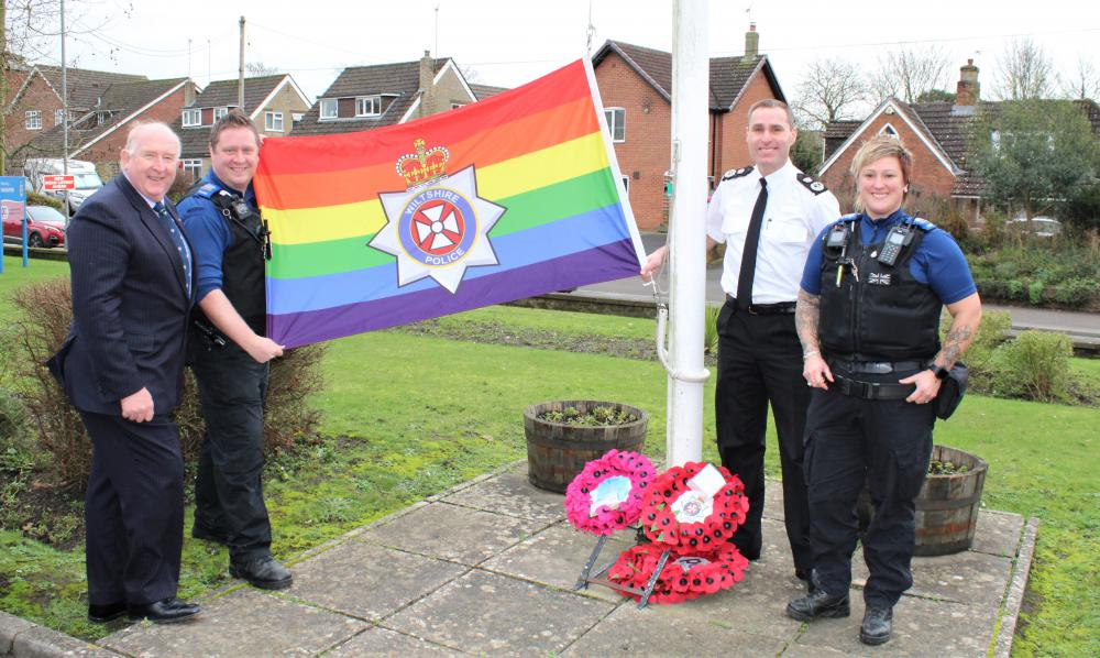 PCC Angus Macpherson raises the rainbow flag with PCSO Lee Hare, Chief Constable Kier Pritchard and PCSO Kate Jackson. Lee and Kate chair our LGBTQ+ staff networ