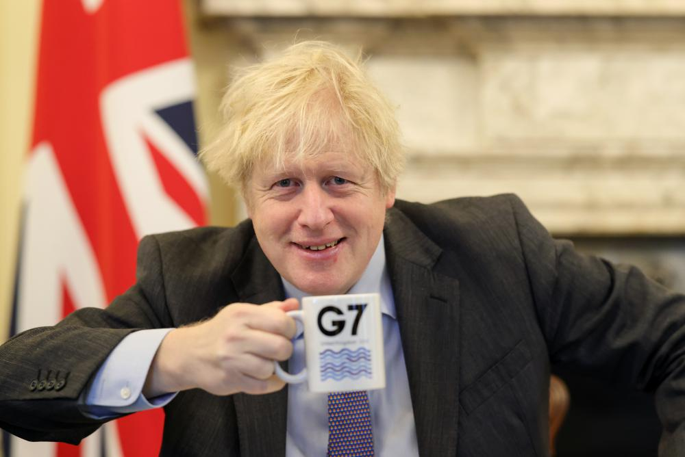 Prime Minister Boris Johnson with a G7 mug - the G7 summit will be held in Cornwall