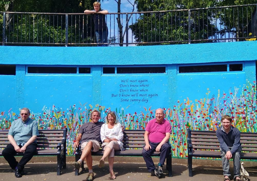 This picture was taken at the unveiling of the memorial mural in Queens Park last month. From left: Coun David Griffiths, artists Gordon and Toni Dickinson, Coun John Firmin, Coun Samuel James. The artists' granddaughter, Isobel, stands above.