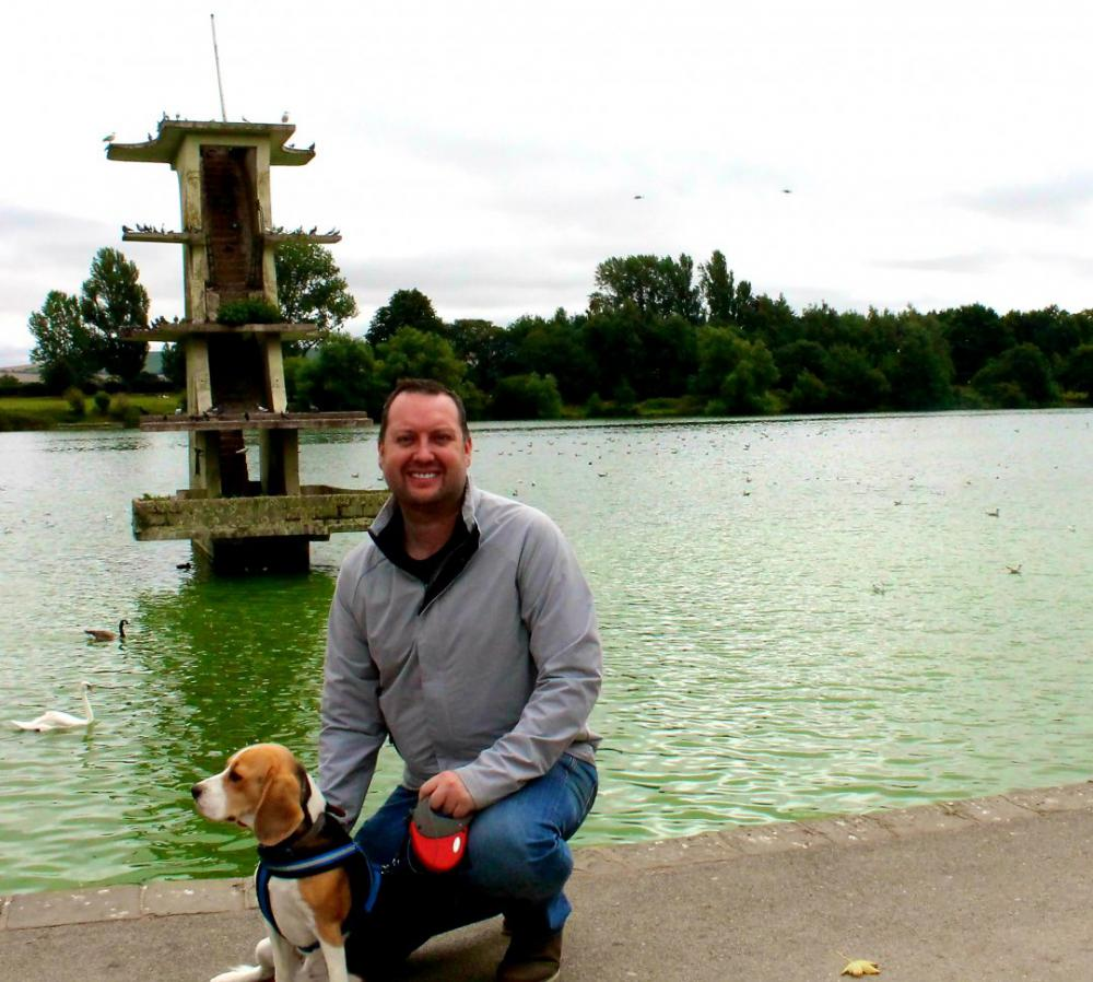 Councillor Dale Heenan and his dog, Juno, at Coate Water