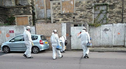 Surveyors entering the building to undertake the hazardous materials survey