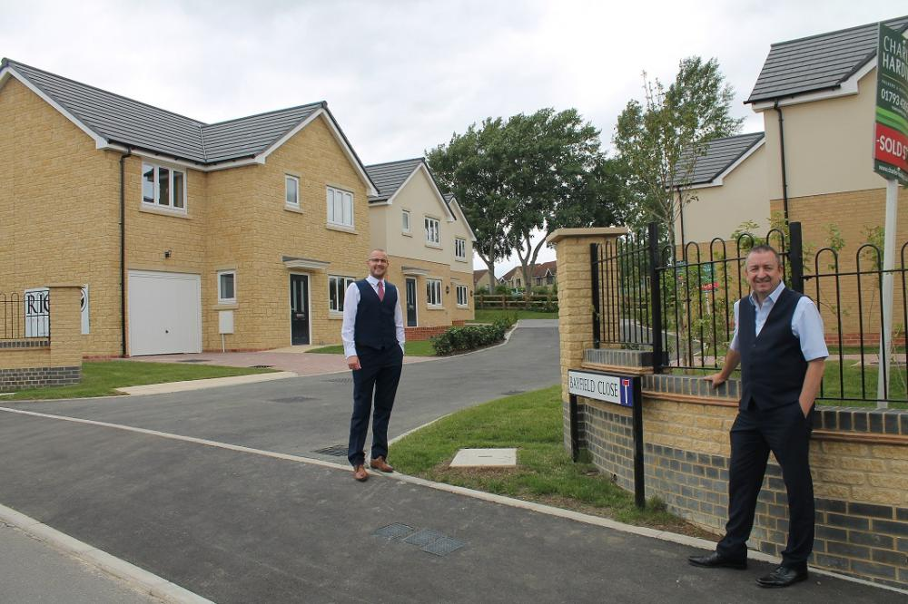 Adam Gatier, Project Director for Swindon Housing Company (left) with Cllr Gary Sumner, Cabinet Member for Strategic Planning, (right) by the new homes.