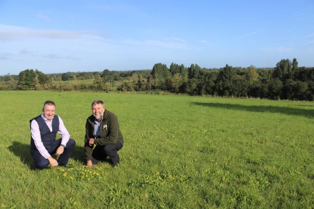 Cllr Gary Sumner (left), Swindon Borough Council's Cabinet Member for Strategic Planning, with WWT Chief Executive Dr Gary Mantle, at Mouldon Hill, one of the sites within the Forest Meadows Project.