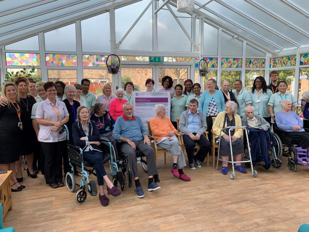 Staff and residents at Whitbourne House celebrating the CQC report