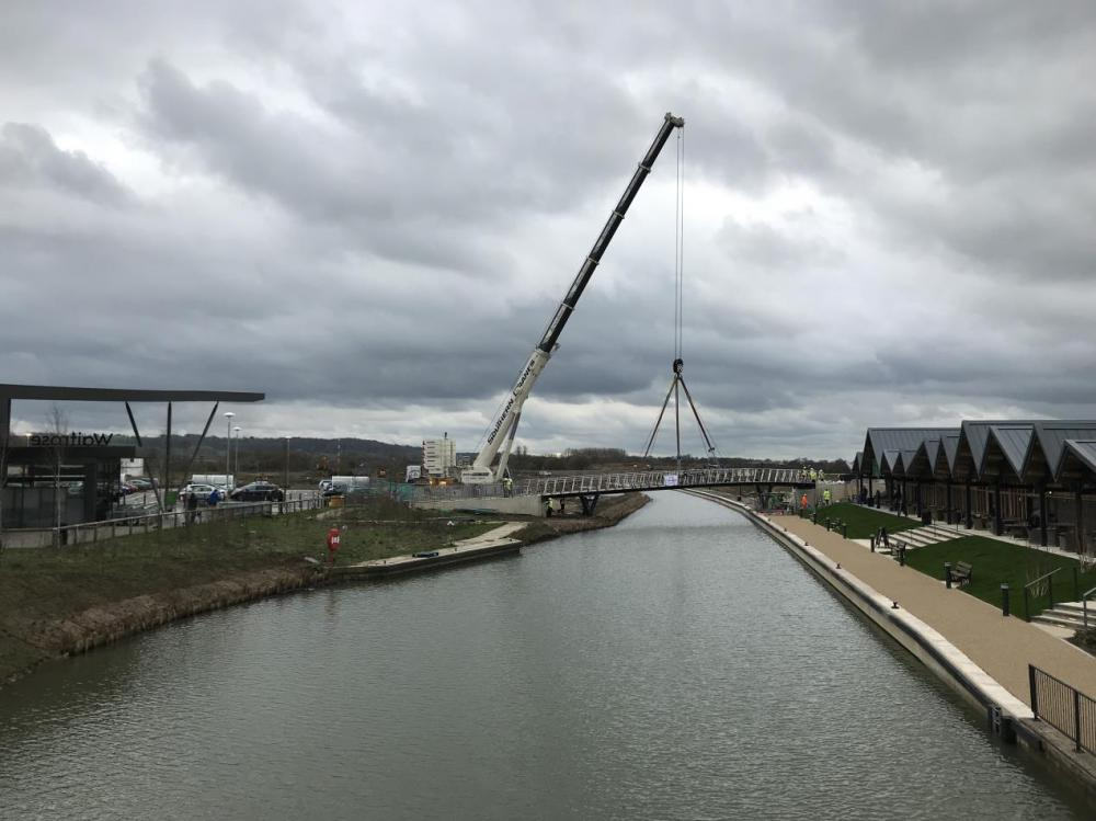 Landmark Wichelstowe footbridge lifted into place