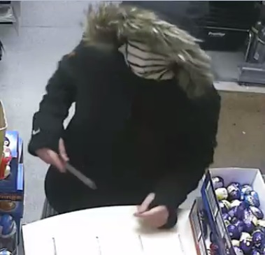 Woman threatened shop worker with knife in attempted armed robbery