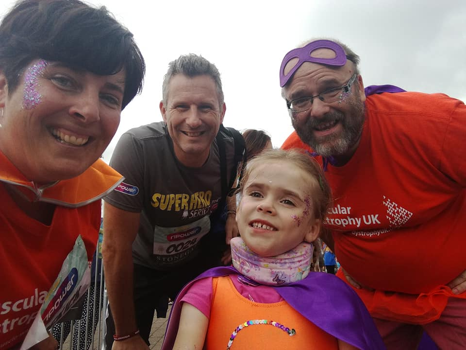 Carmela, aged 4, with parents Lucy and Darren as well as celebrity team mate Adam Hills