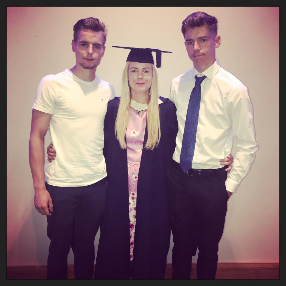 Sarah with her sons Reece, 20, and Kieron, 15