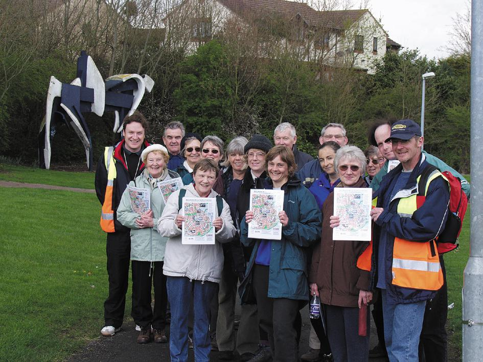 2000: West Swindon Walking Group holding the West Swindon Art Trail Map in front of White Horse Pacified