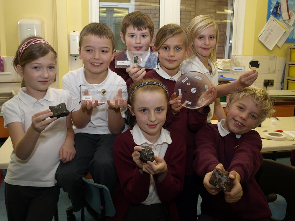 2010 January: Children at Haydon Wick Primary School holding moon rock